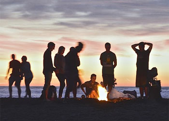 People Having Barbecue on Beach at Sunset