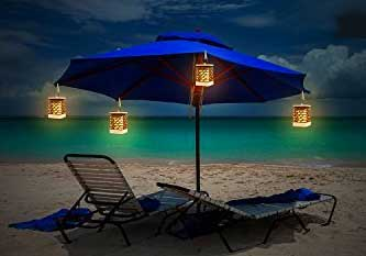 Flickering Solar Lanterns with Clips Attached to Patio Umbrella