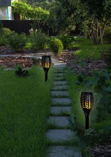 Solar Tiki Torch Lights Along Pathway